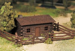 Log Cabin with Rustic Fence